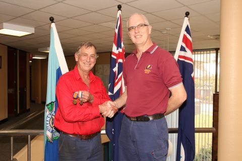 James (left) reunited with his grandfather's medals from Property Officer Chris Carman